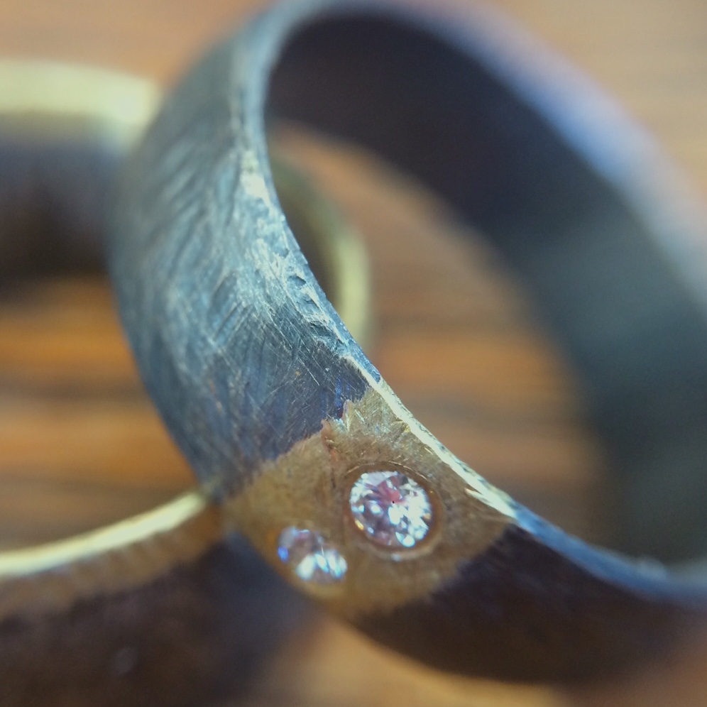 Oxidized Sterling Silver, 18K Gold & Diamond Bands by Heather Guidero
